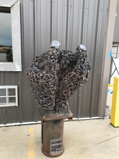 metal hands sculpture